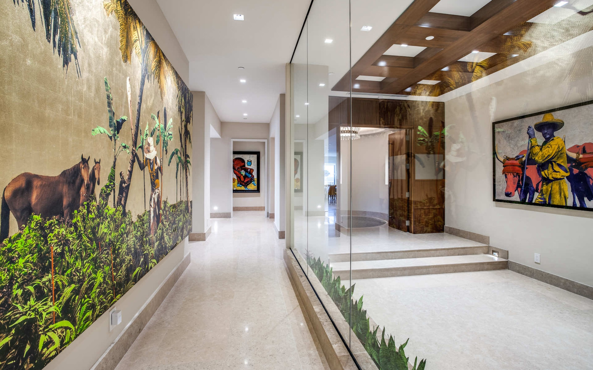 A view down the main hallway with window wall creating an open, airy feeling with the condominium foyer