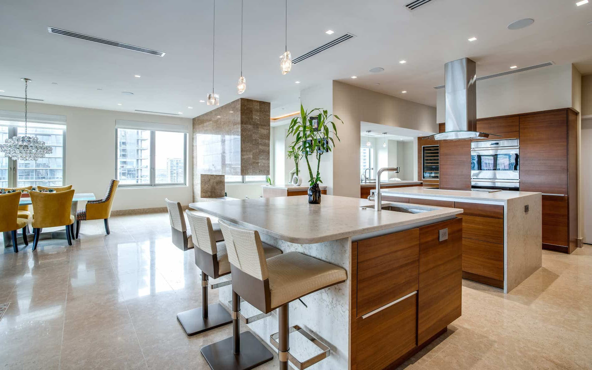 This highrise condo has a contemporary kitchen with two island areas for lots of gathering space
