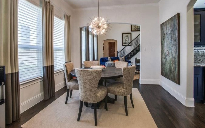 Custom window treatments compliment the dining chairs for a monochromatic scheme with pizazz!